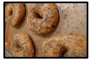 Brush with egg regardless of whether or not you want to top with poppy seeds, sesame seeds, etc.  The egg will help the bagels to brown.