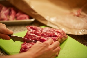 Cutting the meat into strips.