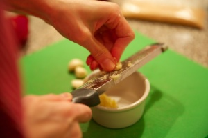 Microplaning the garlic.